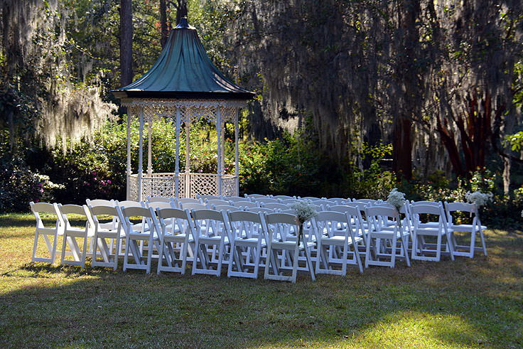 An outdoor wedding setup at Magnolia Plantation in Charleston, SC
