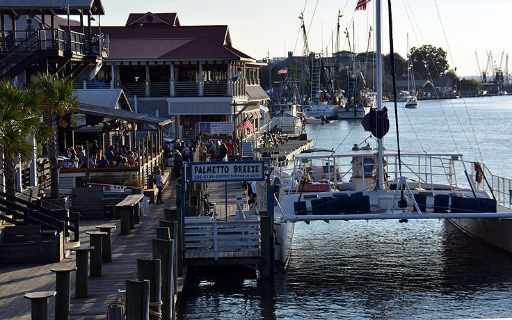 Boats and restaurants line Shem Creek in Mt. Pleasant, SC